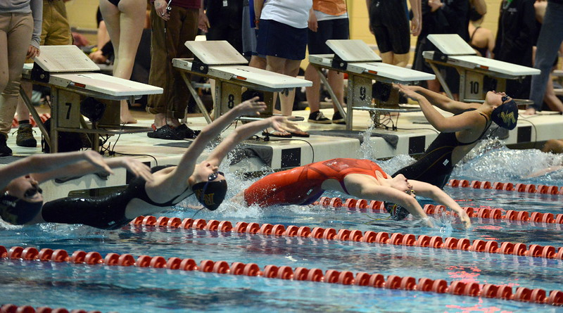 Loveland's Josie Brohard gets off quick at the start of the 100-yard backstroke at Friday's preliminary session of the Front Range League Championships at Veterans Memorial Aquatic Center in Thornton. (Mike Brohard/Loveland Reporter-Herald)