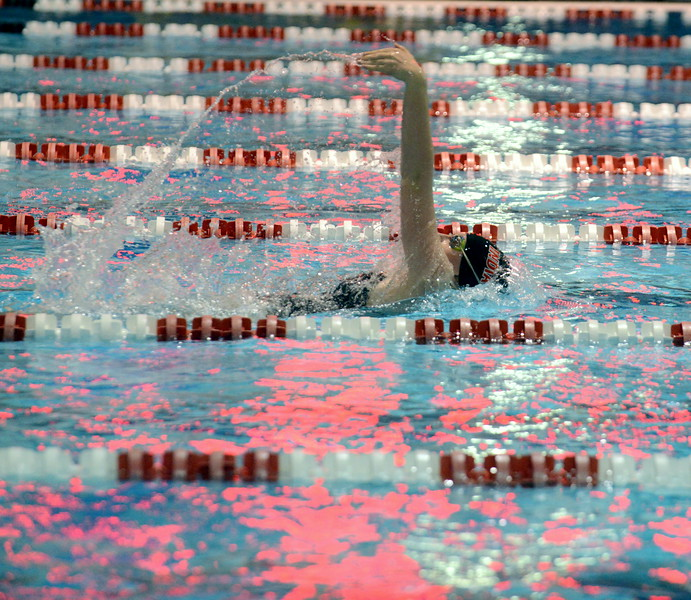 Loveland's Erin Lang separates herself from the field in her heat of the 100-yard backstroke at Friday's preliminary session of the Front Range League Championships at Veterans Memorial Aquatic Center in Thornton. (Mike Brohard/Loveland Reporter-Herald)