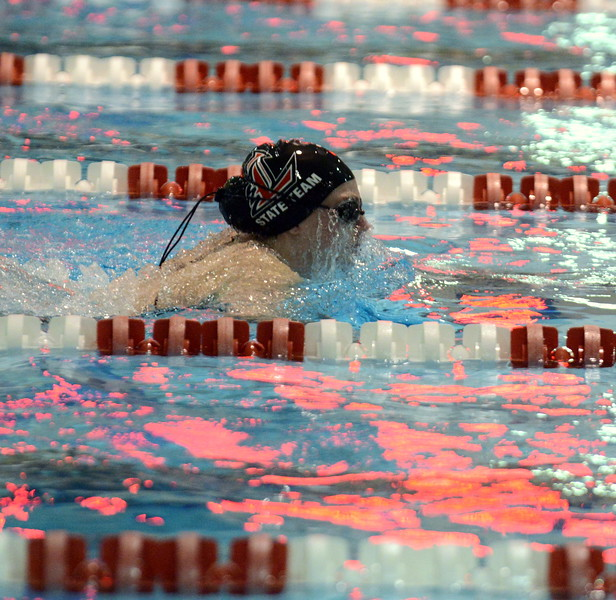 Loveland's Ashley Peet is well in front of her heat in the 100-yard breaststroke at Friday's preliminary session of the Front Range League Championships at Veterans Memorial Aquatic Center in Thornton. (Mike Brohard/Loveland Reporter-Herald)