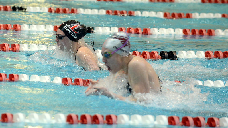 Loveland's Ashley Peet surges ahead of the team from Horizon during the breaststroke leg of the 200-yard medley relay at Friday's preliminary session of the Front Range League Championships. (Mike Brohard/Loveland Reporter-Herald)