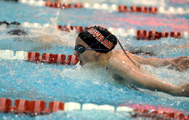 Jordan Reichhardt of Loveland competes in the 100-yard breaststroke at Friday's preliminary session of the Front Range League Championships at Veterans Memorial Aquatic Center in Thornton. (Mike Brohard/Loveland Reporter-Herald)