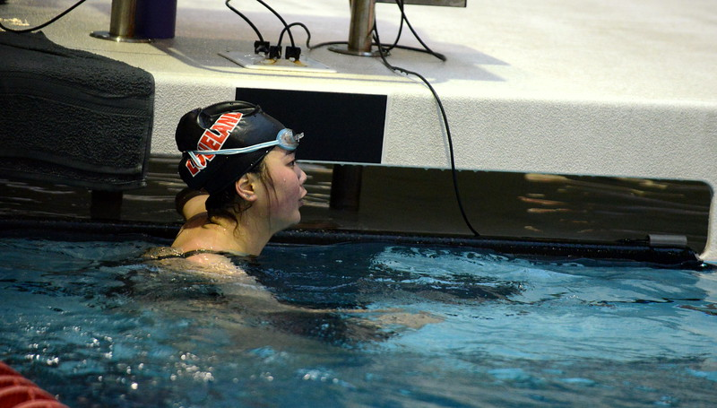 Loveland's Callie Ketner checks the board for her time in the 200-yard freestyle at Friday's preliminary session of the Front Range League Championships. (Mike Brohard/Loveland Reporter-Herald)