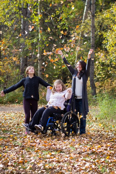 Playing with leaves - Fall family photos Red Deer