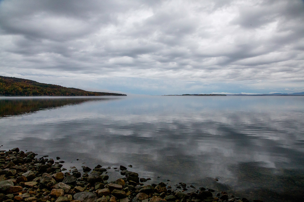 Lake Champlain shoreline (near Port Douglas, NY, Schuyler Island and Vermont in the background) on a calm October day.