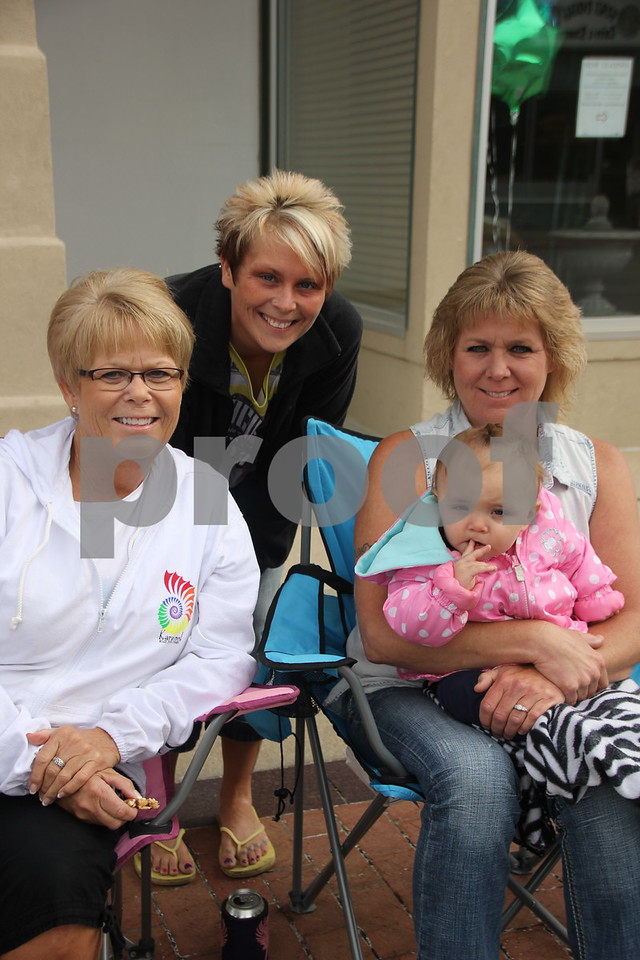 Enjoying the Frontier Days parade are from left to right: Kathy Messerly, Amanda Anderson, Mindy Anderson, and baby Lexy Lawler. The Frontier Days  event  took place on Saturday, June 6, 2015 at Fort Dodge.
