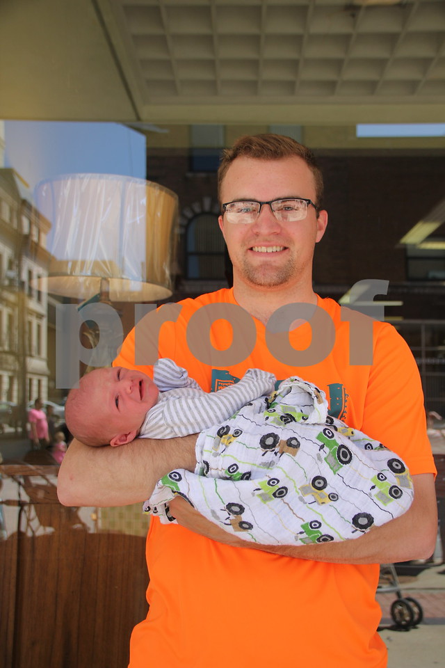 Seen here is: Jon Flattery holding (baby) Vincent Flattery, at the Frontier Days Parade that took place on Saturday, June 4, 2016 in Fort Dodge.