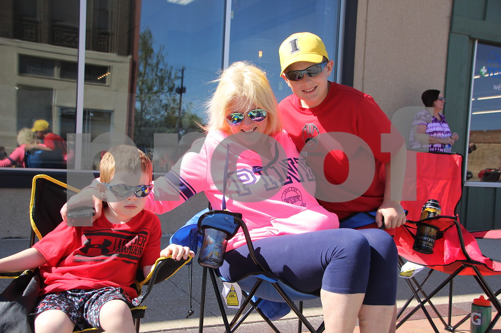 Seen (left to right) is: Brady, Amber, and Drew Temple, some of many people attending the Frontier Days Parade that took place on Saturday, June 4, 2016 in Fort Dodge.