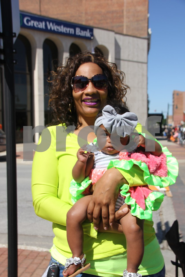 Pictured is: Patrice Green and (baby) Aleah Green, who came to see the Frontier Days Parade that took place on Saturday, June 4, 2016 in Fort Dodge.