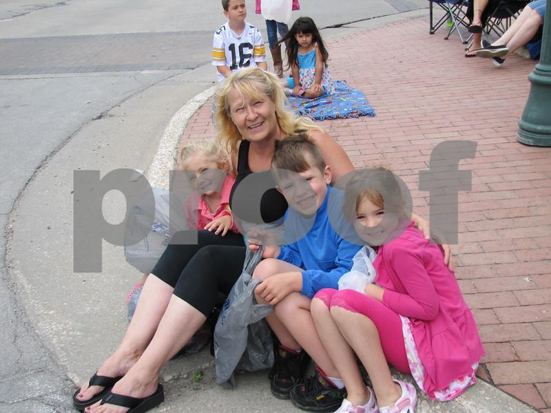 Sophia Doty, Kathy Smith, Teo and Lillian Doty anxiously await the parade to begin.