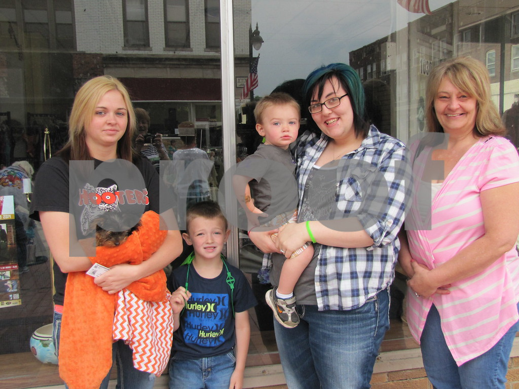 Felicia and Kingston Phillips, Kinnick Phillips, Brittany Hanson, and Crystal Hanson before the parade.