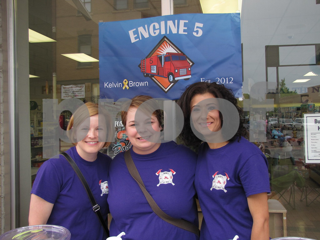 Hope Brown, Denise Kahler, and Victoria Daniel of 'Engine 5' served slushes to folks attending the Frontier Days parade outside Daniel Pharmacy.