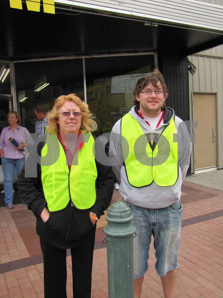 Marsha Waldschimidt and Sean Dollar, employees for DART Transit, were volunteers at the Frontier Days parade.