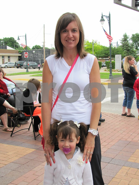 Jenene Friedrichs and her daughter Valyn, were in line to get some popcorn before the parade began.