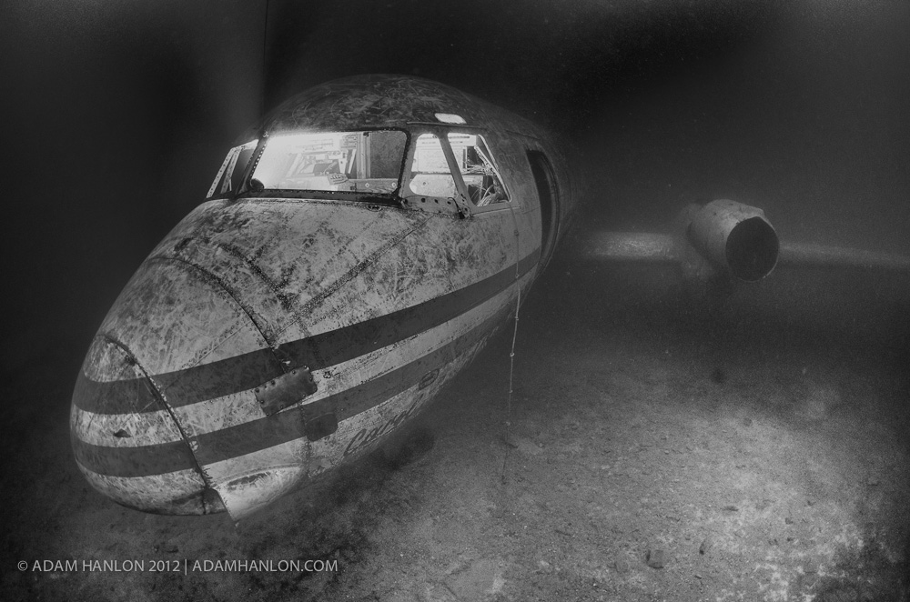 4 strobes (3 off-camera) illumninate this wreck of an HS 748