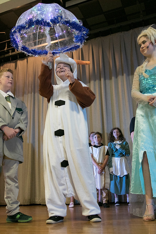 . The Leominster Recreation Department Summer Scene Program is putting on Disney\'s Frozen Jr. at the Samoset Middle School on Wednesday, July 17 and Thursday, July 18, 2019 at 7pm. They had a dress rehearsal on Tuesday, July 16, 2019. Kayla Jakubiak playing Olaf during a scene at the dress rehearsal. SENTINEL & ENTERPRISE/JOHN LOVE