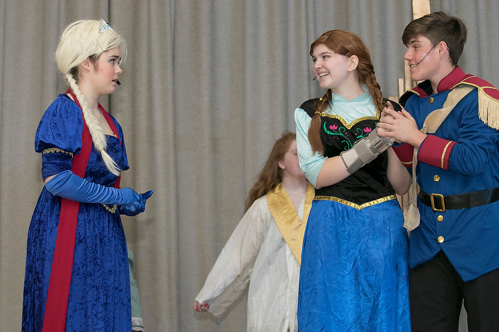 . The Leominster Recreation Department Summer Scene Program is putting on Disney\'s Frozen Jr. at the Samoset Middle School on Wednesday, July 17 and Thursday, July 18, 2019 at 7 pm. They had a dress rehearsal on Tuesday, July 16, 2019. Morgan Eldredge playing Elsa, on left, with Ari Dibble playing Anna and Domenic Iannacone playing Hans perform during a scene at the dress rehearsal. SENTINEL & ENTERPRISE/JOHN LOVE