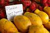 Rambutan and Papaya fruit with don't squeeze sign