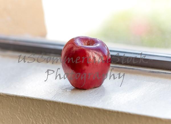 Red Apple on Kitchen Window Sill