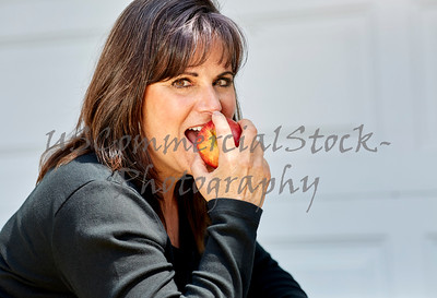 Attractive Woman eating an Apple