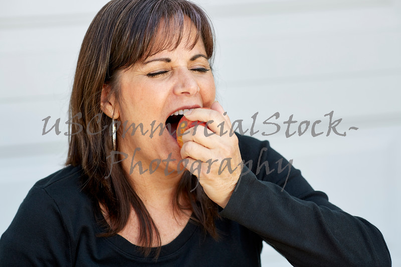 Attractive Woman preparing to bite an Apple