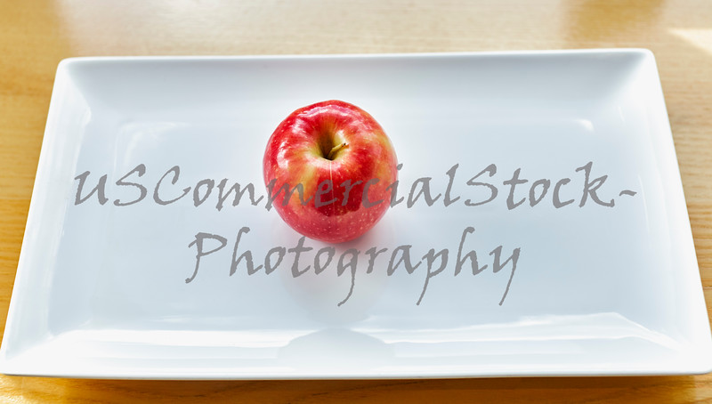 Red Apple on White Plate