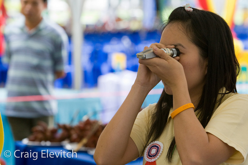 Salak and mangosteen are judged on sugar content using a refractometer.