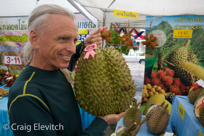 Kerry holds up the winner of the biggest durian (12.6 kg).