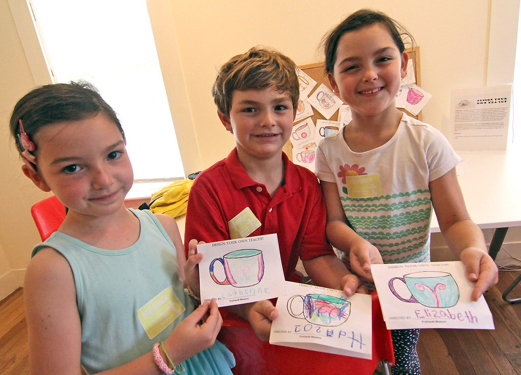 . Showing their tea cup art work  at the Fruitlands Harvest Festival are sisters and brother, L-R, Catherine Finn,6, Joe Finn,5, and Elizabeth Finn, 6, they are from Lincoln and where there with their dad Chris Finn. Nashoba Valley Voice Photo by David H. Brow