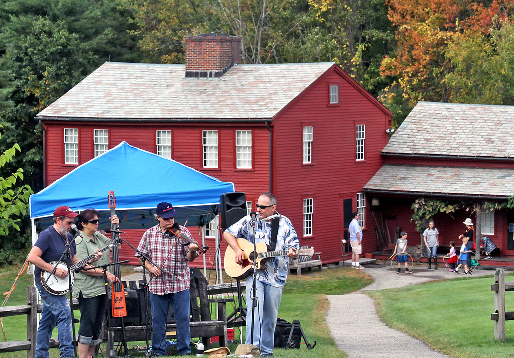 . Music group called the Fruitlands Special, play at the Fruitlands Harvest Festival, L-R, Mark Abare of Westford, Rose Villani and her husband Dan Villani of Bolton, and Ralph DeFlorio of Harvard. Nashoba Valley Voice Photo by David H. Brow