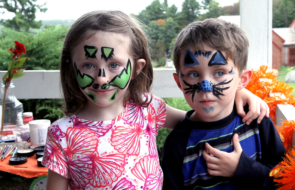 . Sister and brother, Ada-June Snow,7, and Damian Snow, 5, of Lunenburg, show their painted faces at the Fruitlands Harvest Festival in Harvard. Nashoba Valley Voice Photo by David H. Brow