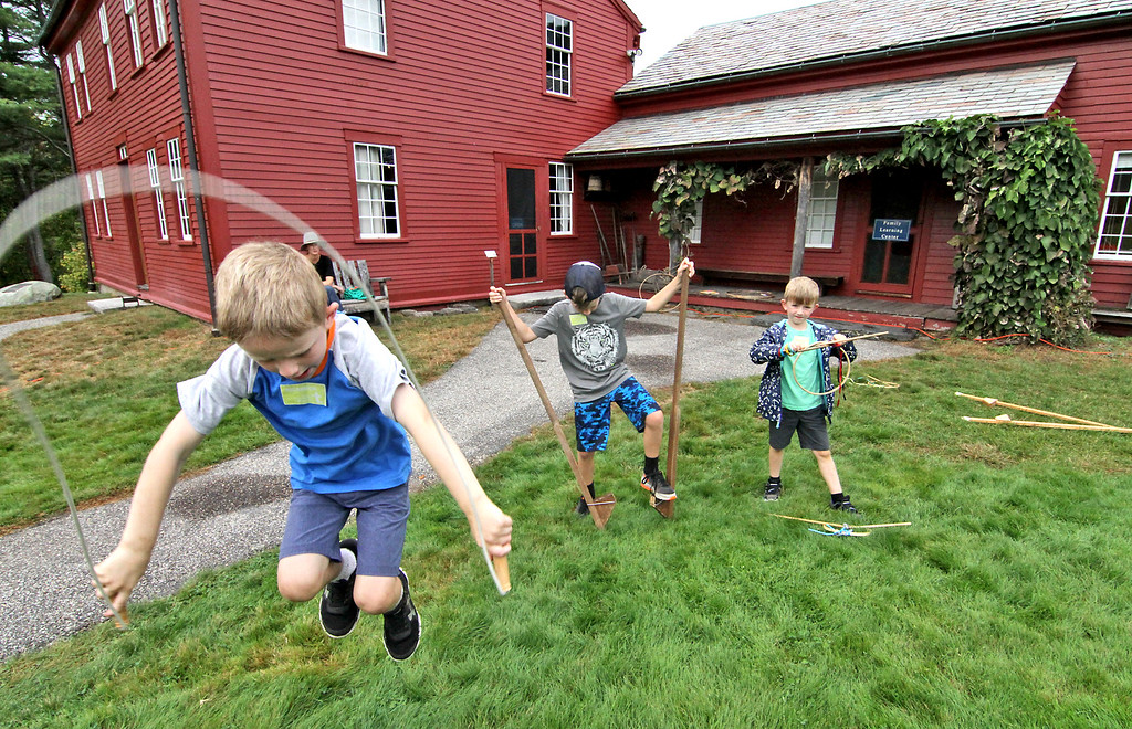 . Playing some of the old timey games at the Fruillands Harvest Festival are brothers L-R, Peter Collins,6 jump rope, Jack Collins,8 stilts and Liam Collins, 6 shooting hoops, the boys are from Westwood. Nashoba Valley Voice Photo by David H. Brow
