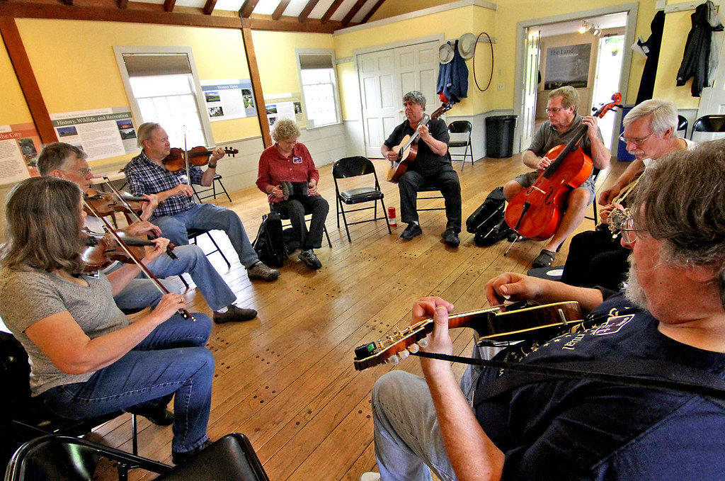 . The Dave & Jo-Anne Sunday Morning Session group sets the mood with livey music at the Fruitlands Museum Harvest Festival. L-R, Jo-Anne Lund, Dave Fox both Westford, Greg  & Linda Wade,Sudbury, John Carew, Littleton, Bill Denison,Nashua NH, Randy Severance, Westford, and Claude Galinsky, Westford. Nashoba Valley Voice Photo by David H. Brow.