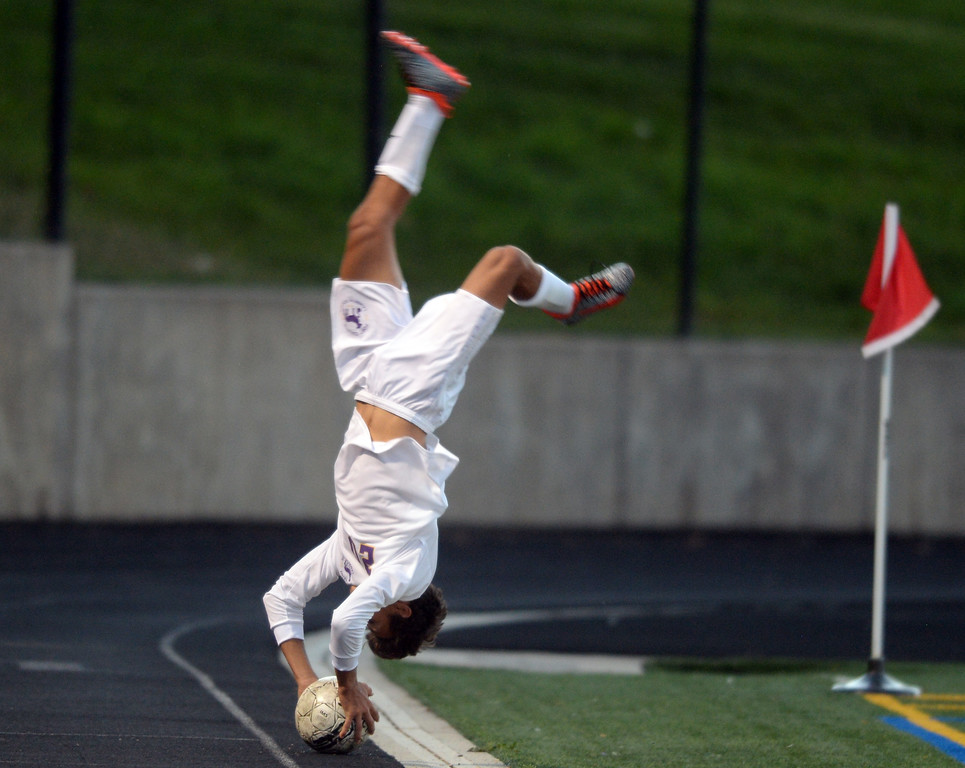 . BOULDER, CO - SEPTEMBER 13: Maurizio Campana, of Ft Collins, executes a flip throw against Boulder. Boulder High played Ft Collins High at Recht Field on Thursday. (Photo by Cliff Grassmick/Staff Photographer)