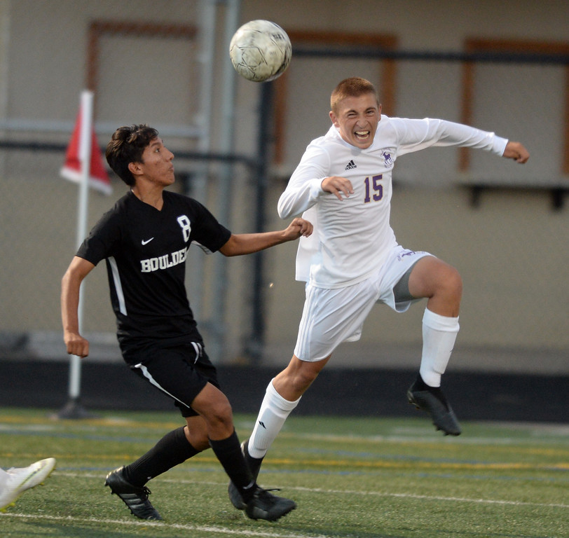 . BOULDER, CO - SEPTEMBER 13: Daniel Zapatero, left, of Boulder, and Thatcher Sanders, of Ft Collins, look to get the ball. Boulder High played Ft Collins High at Recht Field on Thursday. (Photo by Cliff Grassmick/Staff Photographer)