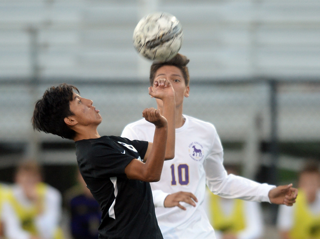 . BOULDER, CO - SEPTEMBER 13: Daniel Zapatero, left, of Boulder, and Fernando Beltran, of Ft Collins, battle for control of the ball. Boulder High played Ft Collins High at Recht Field on Thursday. (Photo by Cliff Grassmick/Staff Photographer)