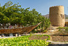 A Portuguese watchtower and boat at the Heritage Center in Fujairah, UAE.