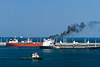 An oil tanker and tugboat at an oil loading facility in Fujairah, UAE.