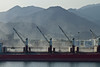 Cargo cranes loading a ship in the port of Fujairah, UAE.