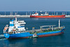 Tugboats at work with an oil tanker in the port of Fujairah, UAE.