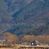 Mountains rise from a lake in Japan Fuji Five Lakes, Yamanashi Prefecture, Japan