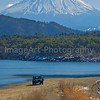 Two people stop their car on the beach to look at Mount Fuji Fuji Five Lakes, Yamanashi Prefecture, Japan
