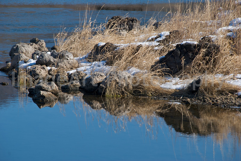 Rocks covered with snow at a lake in Japan Fuji Five Lakes, Yamanashi Prefecture, Japan