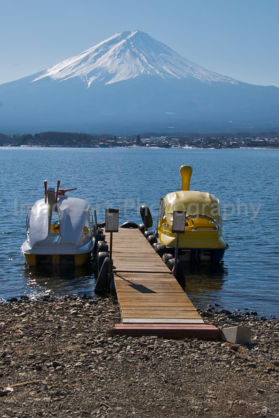 Two pleasure boats tied to a pier in front of Mt. Fuji Fuji Five Lakes, Yamanashi Prefecture, Japan