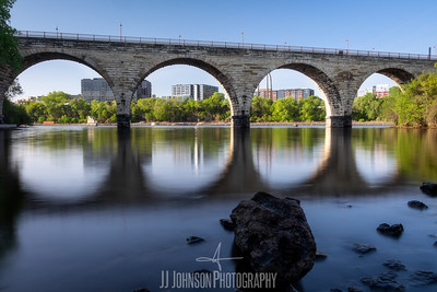 Reflecting the Stone Arch Bridge