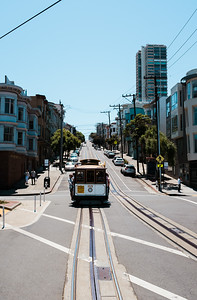 One of the iconic sights, the classic cable car going up the hill