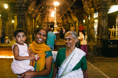 Three generations at the Shri Ponnambalawaneswaram Kovil temple in Colombo Sri Lanka.