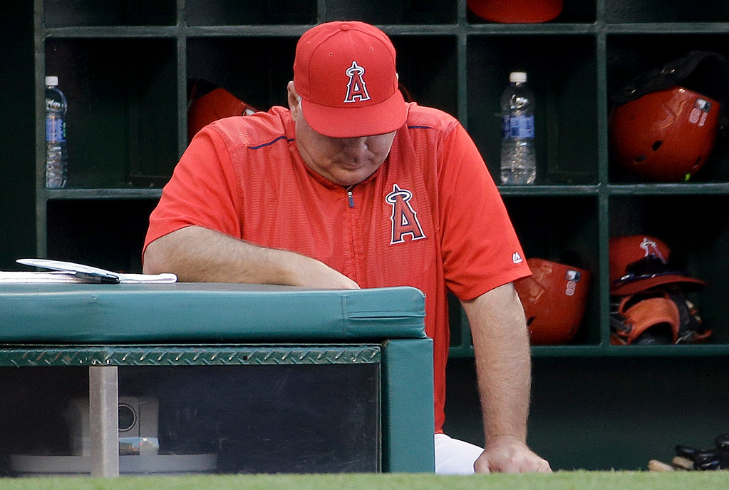 . Los Angeles Angels manager Mike Scioscia stands in the dugout during the ninth inning of the team\'s baseball game against the Detroit Tigers in Anaheim, Calif., Wednesday, June 1, 2016. The Tigers won 3-0. (AP Photo/Chris Carlson)
