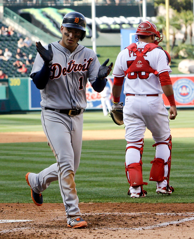 . Detroit Tigers\' Jose Iglesias celebrates after scoring past Los Angeles Angels catcher Carlos Perez on a single by Ian Kinsler during the fifth inning of a baseball game in Anaheim, Calif., Wednesday, June 1, 2016. (AP Photo/Chris Carlson)