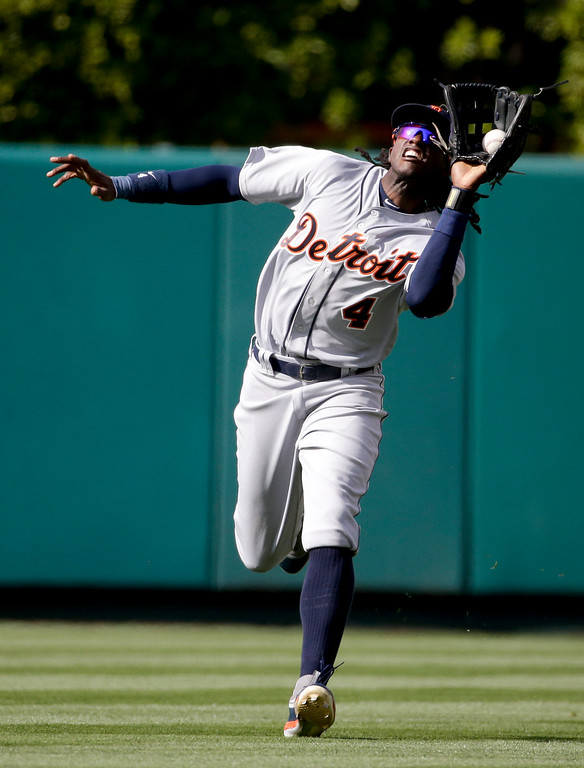 . Detroit Tigers center fielder Cameron Maybin catches a fly ball hit by Los Angeles Angels\' Carlos Perez during the third inning of a baseball game in Anaheim, Calif., Wednesday, June 1, 2016. (AP Photo/Chris Carlson)