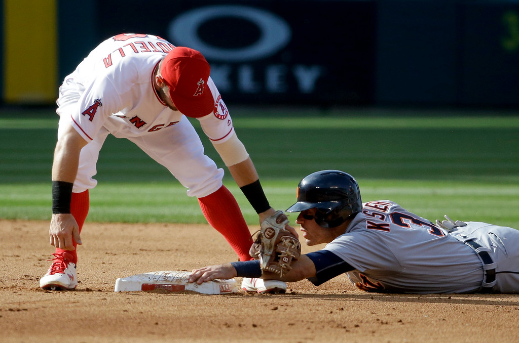 . Detroit Tigers\' Ian Kinsler steals second past Los Angeles Angels second baseman Johnny Giavotella during the fifth inning of a baseball game in Anaheim, Calif., Wednesday, June 1, 2016. (AP Photo/Chris Carlson)